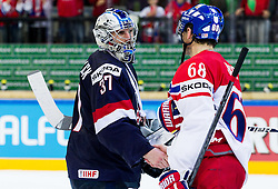 Connor Hellebuyck of USA and Jaromir Jagr of Czech Republic after the Ice Hockey match between USA and Czech Republic at Third place game of 2015 IIHF World Championship, on May 17, 2015 in O2 Arena, Prague, Czech Republic. Photo by Vid Ponikvar / Sportida
