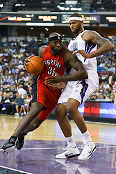 November 1, 2010; Sacramento, CA, USA;  Toronto Raptors power forward Reggie Evans (30) dribbles past Sacramento Kings power forward DeMarcus Cousins (15) during the third quarter at the ARCO Arena. The Kings defeated the Raptors 111-108.