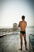 An Australian Lifeguard patrols Merewether Ocean Baths at Merewether Beach, NSW, Australia