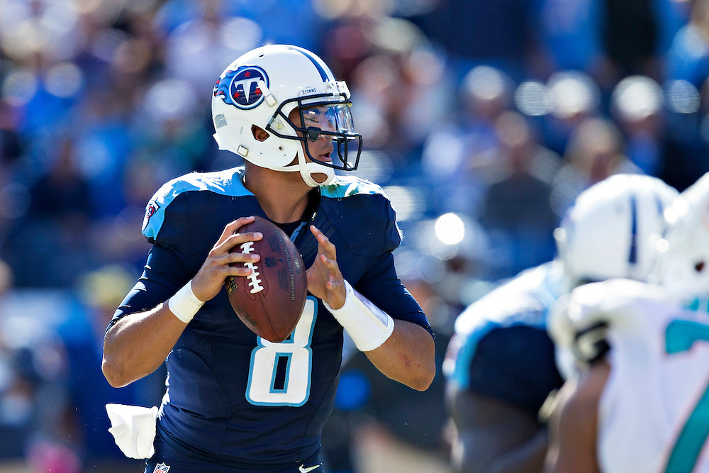 NASHVILLE, TN - OCTOBER 18:  Marcus Mariota #8 of the Tennessee Titans looks for a receiver during a game against the Miami Dolphins at LP Field on October 18, 2015 in Nashville, Tennessee.  The Dolphins defeated the Titans 38-10.  (Photo by Wesley Hitt/Getty Images) *** Local Caption *** Marcus Mariota