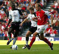 Photo. Chris Ratcliffe. Digitalsport<br /> Fulham v Arsenal. Barclays Premiership. 11/09/2004<br /> Dennis Bergkamp of Arsenal clashes with Moritz Volz and  Papa Bouba Diop of Fulham