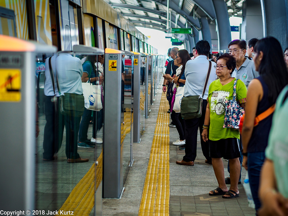 06 DECEMBER 2018 - SAMUT PRAKAN, THAILAND: People wait to board one of the first trains on the new Bangkok BTS Skytrain extension. The 12.6 kilometer (7.8 miles) east extension of the Sukhumvit Line of the Bangkok BTS Skytrain goes into Samut Prakan, a town east of Bangkok.  The system is now 51 kilometers long (32 miles), including the 12.6 kilometer extension that opened December 06. About 900,000 people per day use the BTS.     PHOTO BY JACK KURTZ