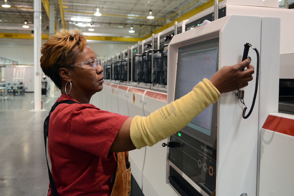 Viola Mitchell works at a machine producing solar panels in the Stion plant on Friday, Jan. 27, 2012. The company is currently producing 130 watt panels in mass production as well as testing new products. Bryant Hawkins/The Hattiesburg American