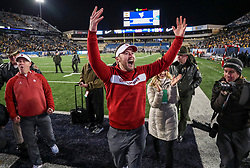 Nov 23, 2018; Morgantown, WV, USA; Oklahoma Sooners head coach Lincoln Riley celebrates with fans after beating the West Virginia Mountaineers at Mountaineer Field at Milan Puskar Stadium. Mandatory Credit: Ben Queen-USA TODAY Sports