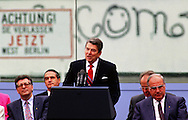 """A 17.7 MG FILE FROM FILM OF:.President Ronald Reagan making his famous """"Mr. Gorbachev tear down this wall"""" speech at the Berlin Wall in 1986 Helmut Kohlis on right. photo by Dennis Brack"""
