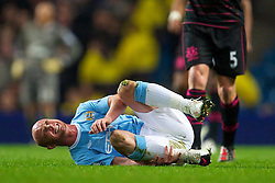 MANCHESTER, ENGLAND - Wednesday, March 24, 2010: Manchester City's Stephen Ireland goes down injured during the Premiership match at the City of Manchester Stadium. (Photo by David Rawcliffe/Propaganda)
