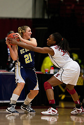 March 19, 2011; Stanford, CA, USA; UC Davis Aggies guard/forward Vicky Deely (21) is defended by Stanford Cardinal forward Nnemkadi Ogwumike (30) during the first half of the first round of the 2011 NCAA women's basketball tournament at Maples Pavilion. Stanford defeated UC Davis 86-59.
