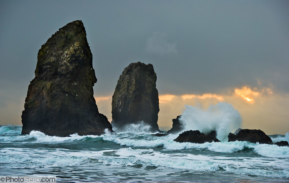 The pounding Pacific Ocean has eroded these sea stack rocks from bluffs at Cannon Beach, Oregon