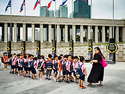 08 JUNE 2018 - SEOUL, SOUTH KOREA: Children in a school group at the War Memorial of Korea in Seoul, South Korea, walk past a memorial to countries who contributed troops to the UN effort in South Korea. With the near constant threat of invasion from North Korea, many South Koreans take great pride in the ability of their armed forces. Some observers believe there is a possibility that a peace agreement between South and North Korea could be signed following the Trump/Kim summit in Singapore. The War Memorial and museum opened in 1994 on the former site of the army headquarters to exhibit and memorialize the military history of Korea. When it opened in 1994 it was the largest building of its kind in the world. The museum features displays about the Korean War and many static displays of military equipment.    PHOTO BY JACK KURTZ
