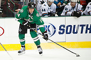 DALLAS, TX - OCTOBER 17:  Jamie Benn #14 of the Dallas Stars controls the puck against the San Jose Sharks on October 17, 2013 at the American Airlines Center in Dallas, Texas.  (Photo by Cooper Neill/Getty Images) *** Local Caption *** Jamie Benn