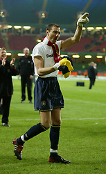 CARDIFF, WALES - Sunday, March 2, 2003: Liverpool's man-of-the-match Jerzy Dudek give his shirt to the fans as he celebrates winning the League Cup after beating Manchester United 2-0 during the Football League Cup Final at the Millennium Stadium. (Pic by David Rawcliffe/Propaganda)