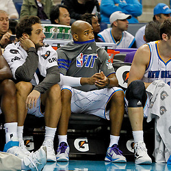 January 29, 2012; New Orleans, LA, USA; New Orleans Hornets center Emeka Okafor (50), shooting guard Marco Belinelli (8), point guard Jarrett Jack (2) and power forward Jason Smith (14) watch from the bench during the fourth quarter of a game against the Atlanta Hawks at the New Orleans Arena. The Hawks defeated the Hornets 94-72.  Mandatory Credit: Derick E. Hingle-US PRESSWIRE