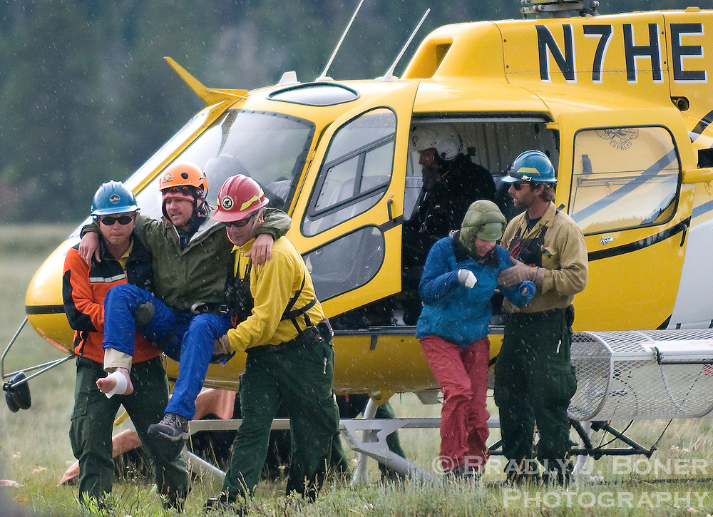 Injured climbers are assisted from a helicopter at Lupine Meadows in July 2011 in Grand Teton National Park. Seventeen climbers in three separate parties required assistance on the Grand Teton when their groups were struck by lightning during a Wednesday morning thunderstorm.