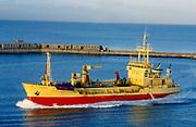 France, Normandy.  Le Havre.  Harbour at dawn - sand dredger.
