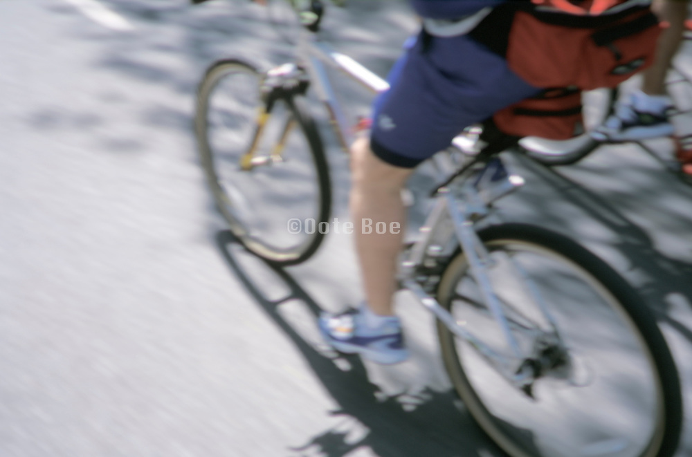 Detail of two people riding bicycles
