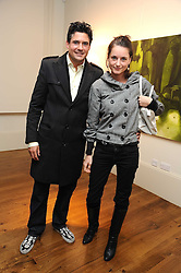 EDWARD TAYLOR and CLEMMIE MAULEVERER at an exhibition of Tahnee Lonsdale's paintings held at The Commander, 47 Hereford Road, London on 8th October 2008.