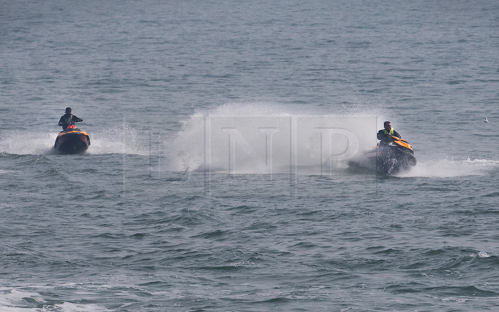 © Licensed to London News Pictures. 22/04/2019. Brighton and Hove, UK. Jet skiers enjoy the surf in Brighton, West Sussex. Most of the UK is enjoying record breaking high Easter weekend temperatures. Photo credit: Peter Macdiarmid/LNP