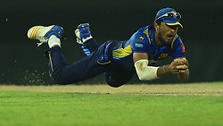 October 23, 2018 - Colombo, Sri Lanka - Sri lankan cricket captain Dinesh Chandimal takes a catch during the 5th One Day International cricket match between Sri Lanka and England at the R Premadasa International cricket ground International Cricket Stadium, Colombo,Sri Lanka. Tuesday 23 October 2018  (Credit Image: © Tharaka Basnayaka/NurPhoto via ZUMA Press)
