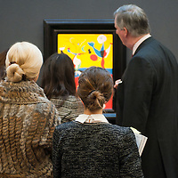 Visitors stand in front of a painting entitled 'Le fermier et son épouse' by Joan Miro (Est. £5.5-7.5 million) during the press preview of the forthcoming Sotheby's February sales of Impressionist & Modern Art and Contemporary Art in London, including works by Picasso, Bacon, Monet, Richter, Miró, Basquiat.