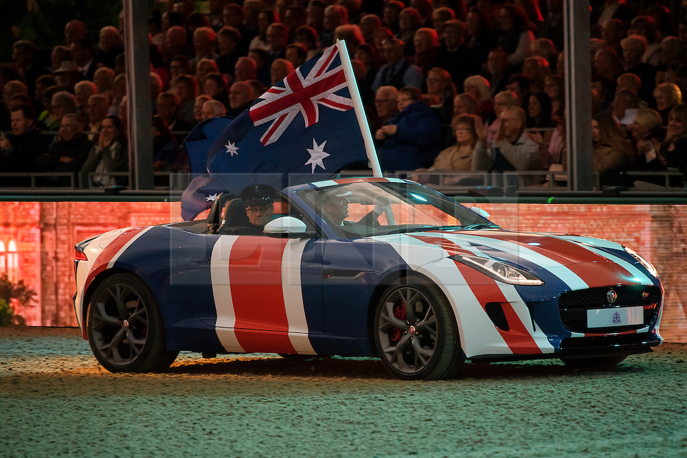 © Licensed to London News Pictures. 15/05/2016. Windsor, UK.  Jaguar cars painted in the union flag. An evening event held at the Royal Windsor Horse show to celebrate the 90th birthday of HRH Queen Elizabeth II. Acts from arounds the world have been invited to perform at the evening event, set in the grounds of Windsor Castle. Photo credit: Ben Cawthra/LNP