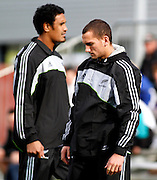 The New Zealand All blacks training session at Yarrow Stadium, New Plymouth, Auckland. Monday 7th June 2010. Jerome Kaino (L) and Aaron Cruden helping with training local U18 and U20 players. Photo: Mike Scott/PHOTOSPORT