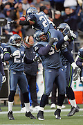 SEATTLE - NOVEMBER 28:  Free safety Ken Hamlin #26 of the Seattle Seahawks celebrates with teammates after pulling down one of his two interceptions against the Buffalo Bills at Qwest Field on November 28, 2004 in Seattle, Washington. The Bills defeated the Seahawks 38-9. ©Paul Anthony Spinelli *** Local Caption *** Ken Hamlin