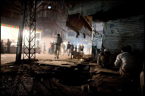 "Addicts prepare doses of heroin hid from the people aside of the closed shop. Lahore, Pakistan, on sunday, November 30 2008.....""Pakistan is one of the countries hardest hits by the narcotics abuse into the world, during the last years it is facing a dramatic crisis as it regards the heroin consumption. The Unodc (United Nations Office on Drugs and Crime) has reported a conspicuous decline in heroin production in Southeast Asia, while damage to a big expansion in Southwest Asia. Pakistan falls under the Golden Crescent, which is one of the two major illicit opium producing centres in Asia, situated in the mountain area at the borderline between Iran, Afghanistan and Pakistan itself. .During the last 20 years drug trafficking is flourishing in the Country. It is the key transit point for Afghan drugs, including heroin, opium, morphine, and hashish, bound for Western countries, the Arab states of the Persian Gulf and Africa..Hashish and heroin seem to be the preferred drugs prevalence among males in the age bracket of 15-45 years, women comprise only 3%. More then 5% of whole country's population (constituted by around 170 milion individuals),  are regular heroin users, this abuse is conspicuous as more of an urban phenomenon. The substance is usually smoked or the smoke is inhaled, while small number of injection cases have begun to emerge in some few areas..Statistics say, drug addicts have six years of education. Heroin has been identified as the drug predominantly responsible for creating unrest in the society."""