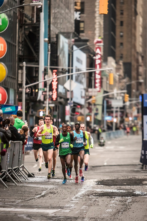 lead pack of men race through Time Square, Sambu,  Barrios, Korir, April