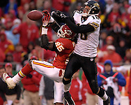Kansas City Chiefs safety Greg Wesley (25) brakes up a pass intended for Jacksonville wide receiver Matt Jones (18) in the second half at Arrowhead Stadium in Kansas City, Missouri, December 31, 2006.  The Chiefs beat the Jaguars 35-30.<br />