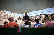 Instructor Eitan Cohen explaining basic  weapons and ammunitions technique, the family will later shoot with different type of guns, pistols, rifles.