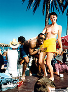Semi naked woman and man dancing on a beach table, Bora Bora Bar, Playa D'en Bosa, Ibiza 1999