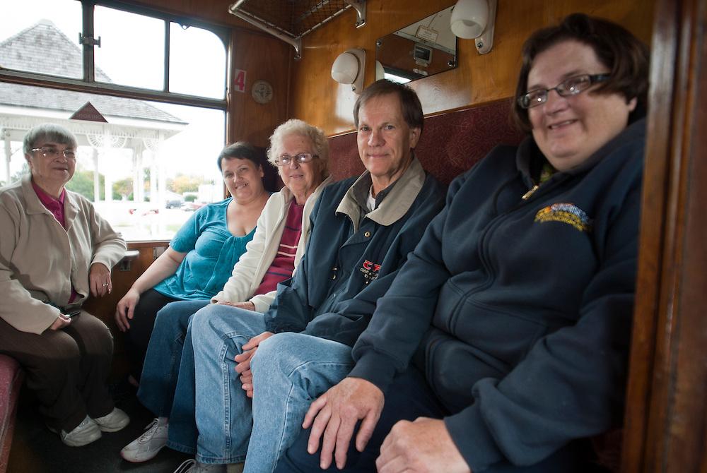 Lathan Goumas   The Bay City Times..Ardith Fales, secretary, Sue Stein, director, Mina Stodolak, decorator, Mark WInslow, Standish Mayor, and Carrie Stodolak at the Standish Historic Depot in Standish, MI.
