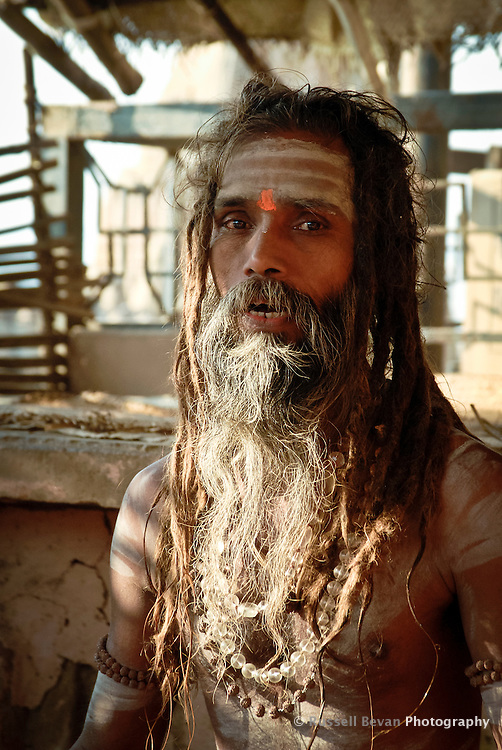 A Hindu holy man Chanting at the ghats in Varanasi, Uttar Pradesh, India