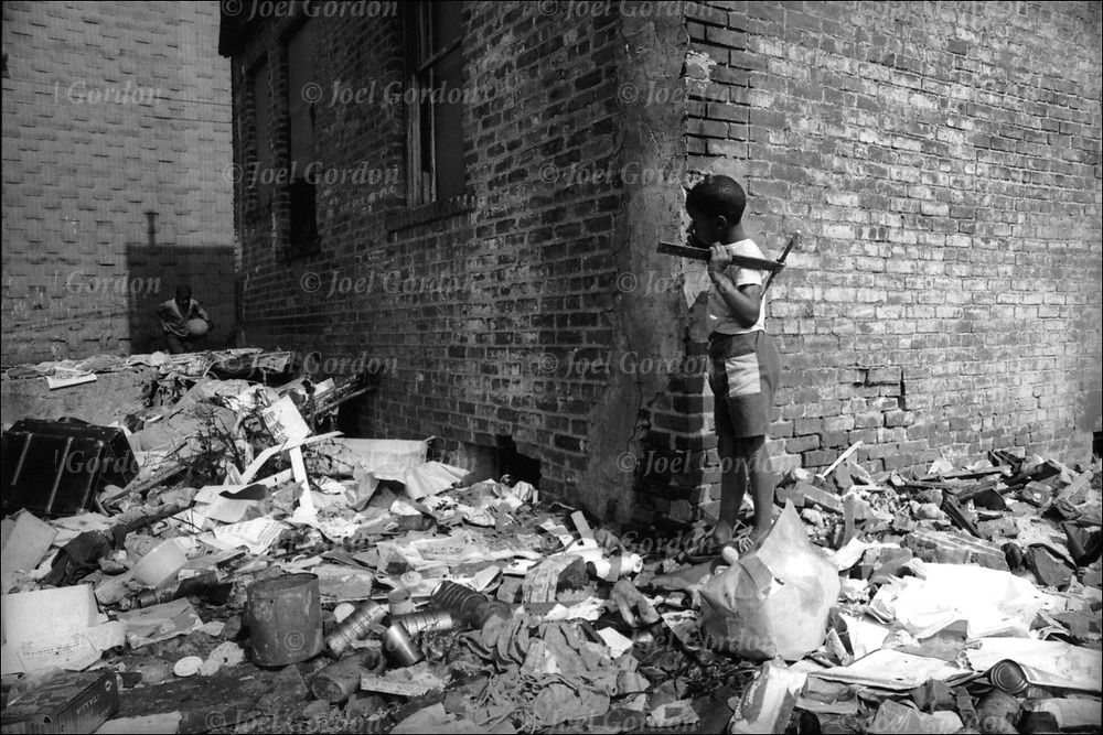 Inner city poverty  in high drug crime area, South Bronx, Brooklyn, NY.   African American inner city children play in rubble. <br />