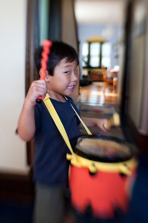 Holden Miller, 4, bangs on his toy drum while playing at the Miller/Stute home in Madison, Wis., on Sept. 11, 2011.