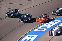 November 10, 2018 - Phoenix, Arizona, U.S. - PHOENIX, AZ - NOVEMBER 10:  JJ Yeley (38), Tommy Joe Martins (8) and Ross Chastain (4) Flex Seal Chevrolet racing 3-wide into the turn at the NASCAR Xfinity Series Playoff Race - Whelen 200  on November 10, 2018 at ISM Raceway in Phoenix, AZ.  (Photo by Lyle Setter/Icon Sportswire) (Credit Image: © Lyle Setter/Icon SMI via ZUMA Press)