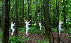 Edinburgh, Scotland, UK. 9 August 2019. Trisha Brown: In Plain Site reconceives some of the US choreographer's most striking short dance pieces in dynamic relationships with the enchanting landscape of Jupiter Artland — on floating rafts in Charles Jencks' lakes, in its rich woodlands and sculpted landforms.Credit; Iain Masterton/Alamy Live News ++ Editorial Use Only ++