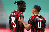 AC Milan's Ivorian midfielder Franck Kessie discusses with Algerian midfielder Ismael Bennacer during the Serie A match at Giuseppe Meazza, Milan. Picture date: 28th June 2020. Picture credit should read: Jonathan Moscrop/Sportimage