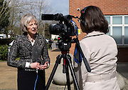 © Licensed to London News Pictures. 01/04/2015. Abingdon, UK. Theresa May gives a TV interview.  Theresa May gives a TV interview.  Home secretary, Theresa May and Nicola Blackwood, Parliamentary candidate for Abingdon visit Abingdon Police Station today following recent arrests for human exploitation, slavery and fraud. . Photo credit : Stephen Simpson/LNP