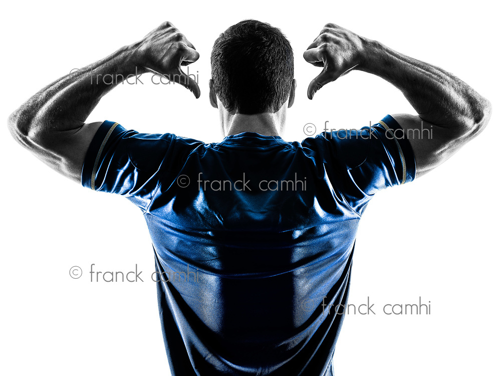 one caucasian soccer player man standing Rear View pointing in silhouette isolated on white background