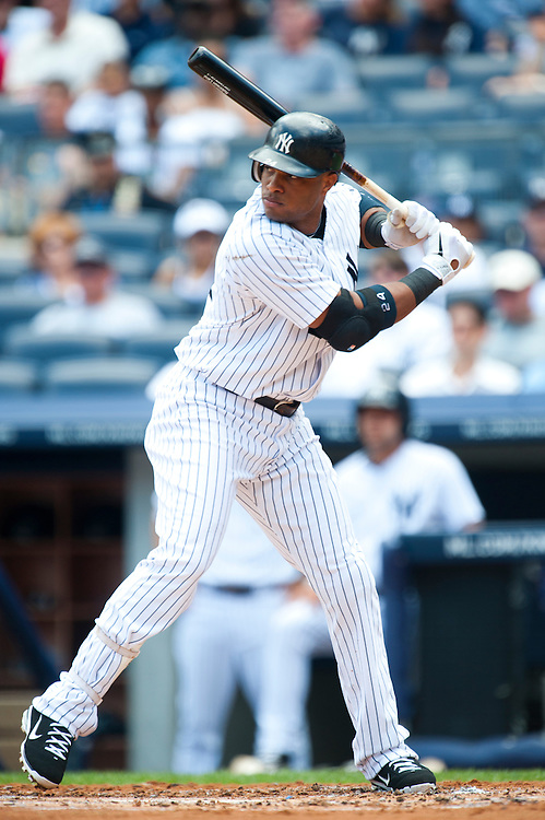 NEW YORK - JULY 27: Robinson Cano #24 of the New York Yankees bats during the game against the Seattle Mariners at Yankee Stadium on July 27, 2011 in the Bronx borough of Manhattan. (Photo by Rob Tringali) *** Local Caption *** Robinson Cano
