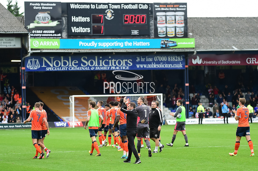 The Luton players leave the pitch in front of the scoreboard showing todays 7-1 scoreline during the EFL Sky Bet League 2 match between Luton Town and Stevenage at Kenilworth Road, Luton, England on 14 October 2017. Photo by Dennis Goodwin.