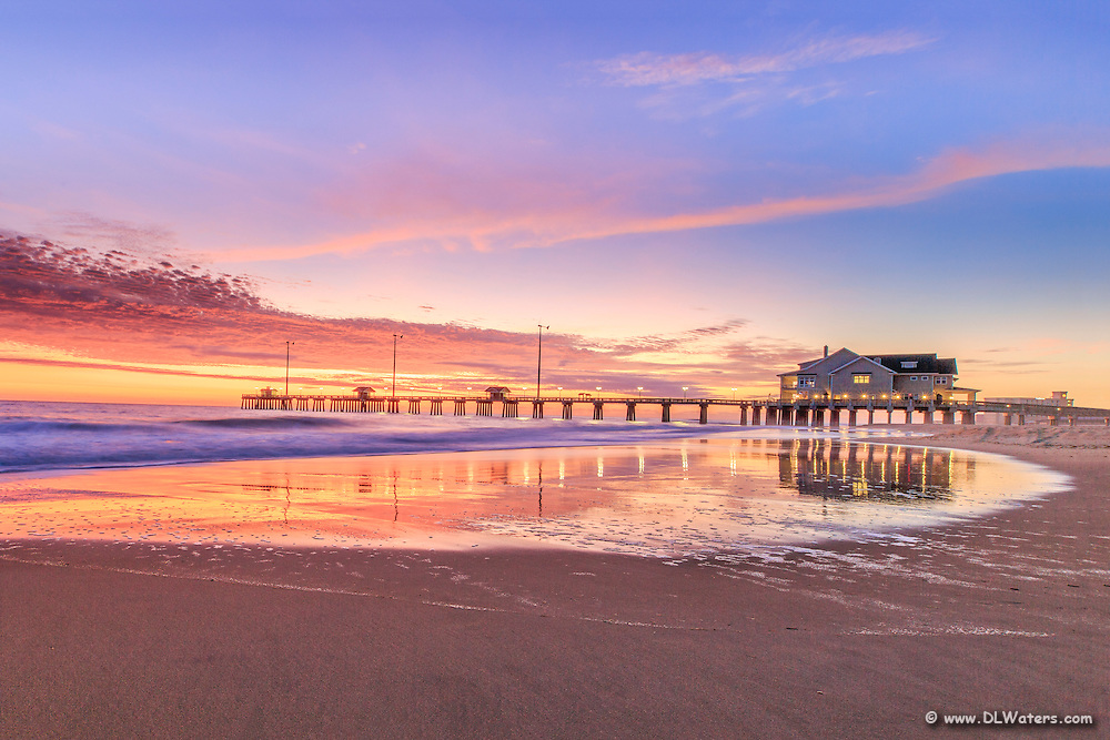 Jennette's Pier reflected in the receding surf on a early morning in Nags Head, NC.
