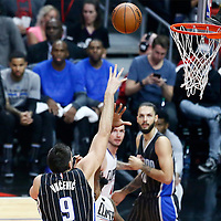 11 January 2017: Orlando Magic center Nikola Vucevic (9) goes for the baby hook over LA Clippers center DeAndre Jordan (6) during the LA Clippers 105-96 victory over the Orlando Magic, at the Staples Center, Los Angeles, California, USA.