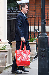 © Licensed to London News Pictures. 03/04/2019. London, UK. Foreign Secretary JEREMY HUNT carrying a bag as he leaves his grace and favours home in Westminster, London. British Prime Minster Theresa May has offered to work with Labour Party leader Jeremy Corbyn, in an attempt to pass a deadlock in the commons on her withdrawal agreement. Photo credit: Ben Cawthra/LNP
