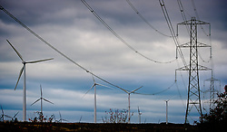Wind turbines and electricity pylons on the Black Law Wind Farm, South Lanarkshire, Scotland<br /> <br /> (c) Andrew Wilson | Edinburgh Elite media