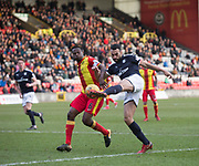 17th February 2018, Firhill Stadium, Glasgow, Scotland; Scottish Premier League Football, Partick Thistle versus Dundee; Steven Caulker of Dundee battles for the ball with Abdul Osman of Partick Thistle
