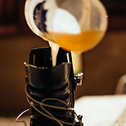 Joseph Paine drinks a served beer from a ski boot during a practice session for team Hostel X.