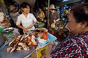 Cholon (Chinatown). Binh Tay Market. Woman selling roasted meat.
