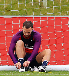 England's Danny Drinkwater (Leicester City) ties his boot laces - Mandatory byline: Matt McNulty/JMP - 22/03/2016 - FOOTBALL - St George's Park - Burton Upon Trent, England - Germany v England - International Friendly - England Training and Press Conference